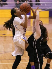 Kirtland Central's Haile Gleason drives to the basket