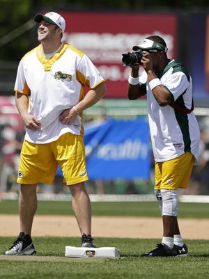 Randall Cobb borrows a camera and works the game from the field during the Jordy Nelson Charity Softball Game at Neuroscience Group Field at Fox Cities Stadium in 2016.