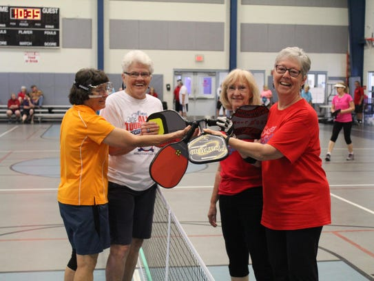 Pickleball teammates and victors (from left) Mary Bowers