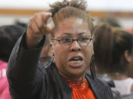 Beverly Watson of Airmont confronts school board members during a March 28 meeting on proposed school budget cuts at the East Ramapo Central School District central administration building in Spring Valley.