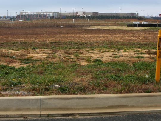 This vacant land behind Walmart will be developed into apartment housing in Middletown.