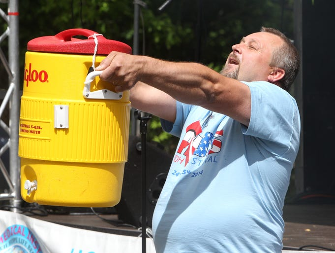 Robert Milik of Suffern competes in the strong man contest at the 6th PLUS Polish festival at the German Masonic Park Tappan May 24, 2014.