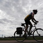 Kurt Griffin leaves the Pasley Park rest stop station on the bike path during Tour Sioux Falls in 2014.