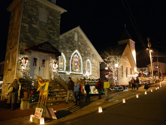 Visitors walk by the Jarrett Memorial Church in Dillsboro