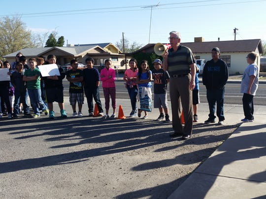George Ruth, president of Citizens Bank of Las Cruces, uses a bullhorn to address a crowd gathered for a Wednesday morning ribbon cutting ceremony. The bank donated a new digital marquee, valued at $17,000, to the school.