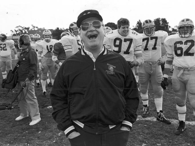 Bo Schembechler shares a laugh with the Michigan team