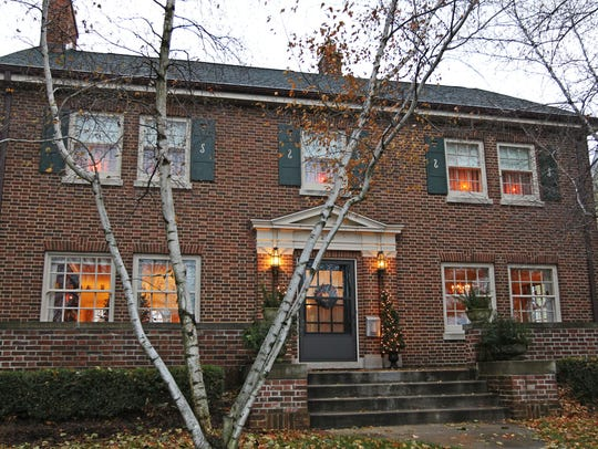 The three-story 1926 brick Colonial Revival home has
