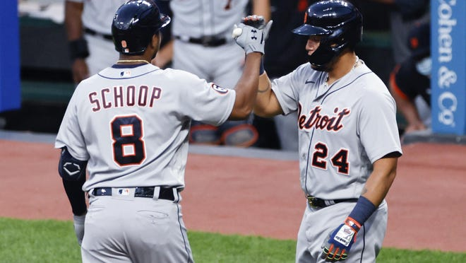 Detroit Tigers' Jonathan Schoop (8) celebrates with Miguel Cabrera (24) after hitting a two run home run off Cleveland Indians starting pitcher Adam Plutko during the fourth inning of a baseball game, Friday, Aug. 21, 2020, in Cleveland.