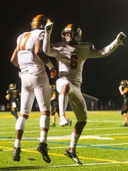 Woodrow Wilson wide receiver Fadil Diggs (17) celebrates a touchdown with running back Emelio Pena (6) against Moorestown at Moorestown High School on Friday, October 6.