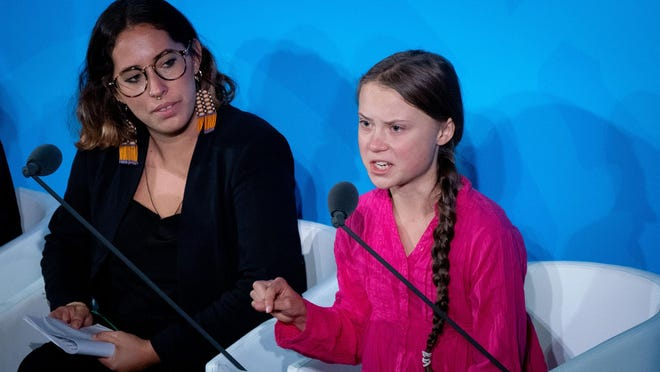 NEW YORK -- Climate activist Greta Thunberg, right, speaks at the United Nations Climate Change Conference in September.