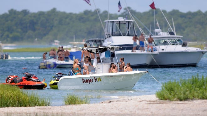 Several thousand people celebrate the Fourth of July each year on and around Masonboro Island, seen here in 2018.