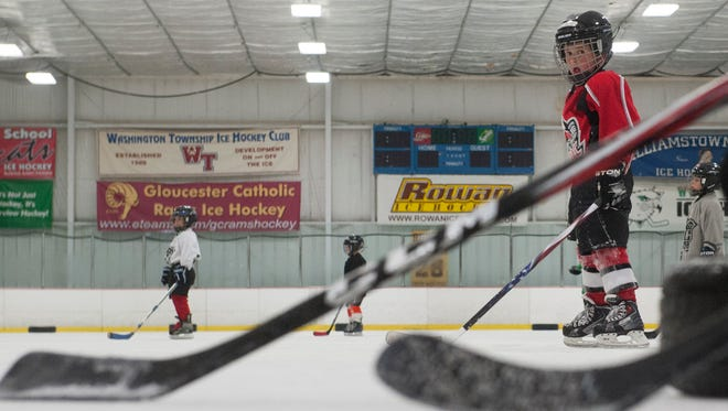Youth players wait for instruction on the ice during a practice at Hollydell Ice Arena Rink.