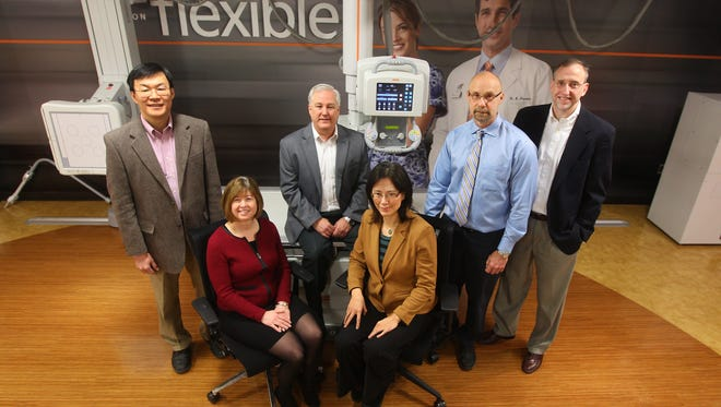 Front row, from left, Carestream researchers Susan Parulski, Chief Patent Counsel and Zhimin Hou, Senior Research Scientist. Back row, from left, Victor Wong, Reasearch and Innovation Lab, Jimmy Ogle, Digital Medical Solutions, David H. Foos, Director, Research and Innovation Lab, William C. Wendlandt, Project Manager, X-Ray solutions, Advanced Development.