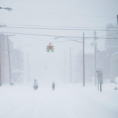 Pedestrians make their way through downtown Endicott