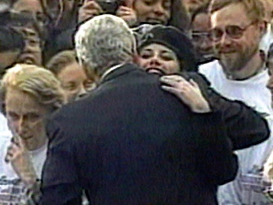 "In this image taken from video, Monica Lewinsky embraces President Clinton as he greeted well-wishers at a White House lawn party in Washington Nov. 6, 1996. The Clinton White House years are parodied in the new Off-Broadway musical, ""Clinton the Musical,"" this spring."