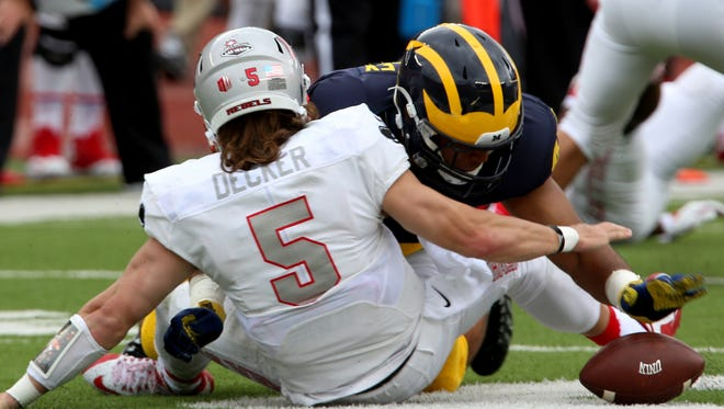 Michigan's Chris Wormley goes after the football after UNLV quarterback Blake Decker fumbled it but it was recovered by a teammate during the first quarter Saturday in Ann Arbor.