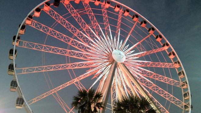 The 360 Pensacola Beach observation wheel went red in an attempt to have more sea turtle-friendly lighting. Bright lights disorient hatchlings and keep them from the Gulf of Mexico. S