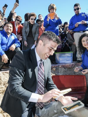 Sunland Park Mayor Javier Perea pulls the key to the city out of a time capsule as the 14,000-resident border city marked its 30th birthday on Jan. 11, 2014, at Elena Memorial Plaza. Now a small group of residents is looking to dissolve the city government after dissatisfaction with its elected leaders, two of whom have recently been arrested.