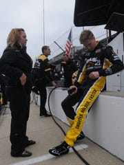 Team owner, Sarah Fisher talks with driver Josef Newgarden