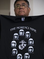 Joe Sorrelman holds up a Morenci Nine shirt, showing