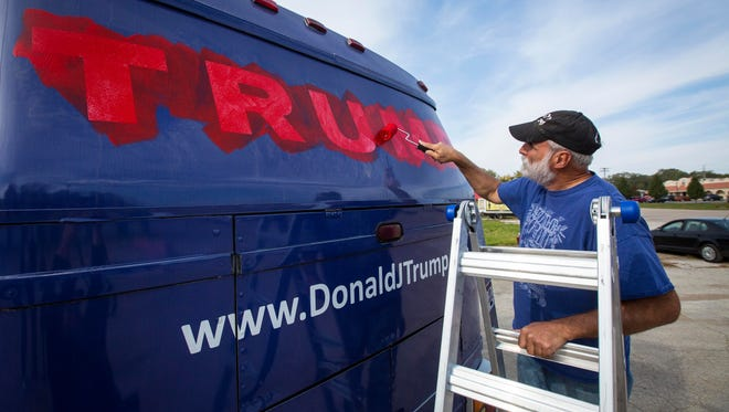 A campaign bus used for the presidential hopeful Donald Trump in Iowa was bought by t.Rutt a writer, entrepreneur, economist, and artist (according to his website). Artist Mike Stevens paints over the Turmp logos Monday Oct. 19, 2015, making it a mobile art piece per the instructions of artist t.Rutt.