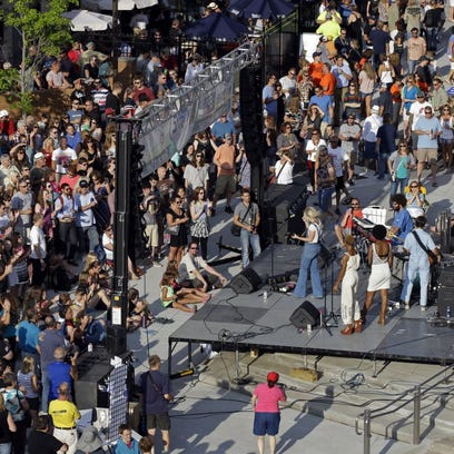Crowds take in a concert at Houdini Plaza during the 2014 Mile of Music festival in downtown Appleton.