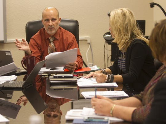 Lee County Schools Superintendent Greg Adkins meets with the assistant superintendents earlier this year.