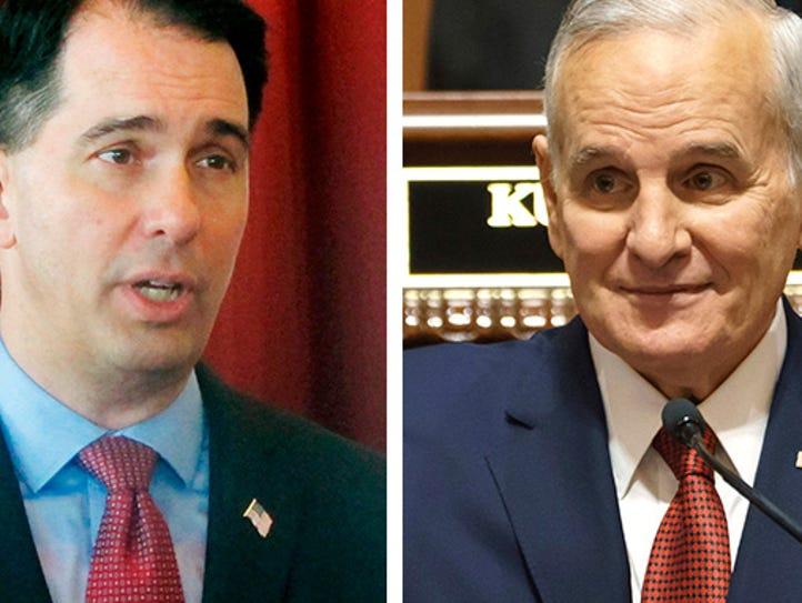 Wisconsin Gov. Scott Walker (left) and Minnesota Gov.