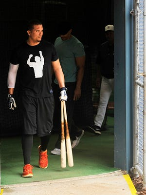 Tigers' Victor Martinez exits the batting cages on Monday in Lakeland.