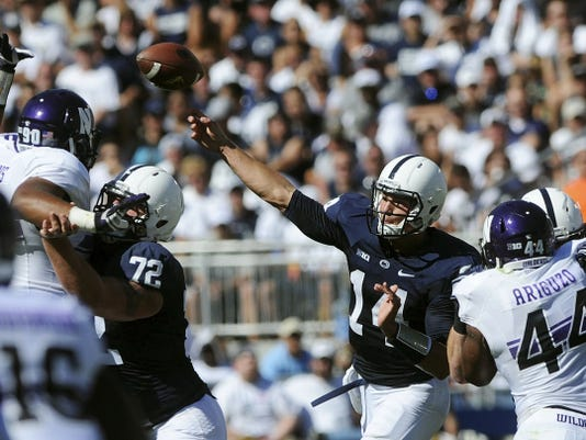 """Penn State quarterback Christian Hackenberg delivers a pass as his offensive line gives him time to work during a September game against Northwestern. The offensive line struggled because of depth an inexperience last season, but coach James Franklin said the comparison with this season's improved line is """"night and day."""""""