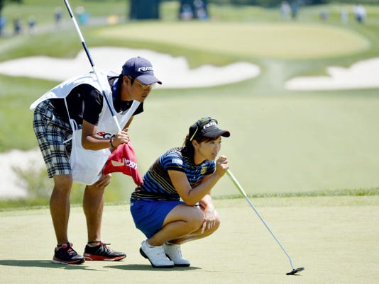 Rumi Yoshiba and her caddie Makoto Sato examine the second green during Saturday's third round of the U.S. Women's Open at Lancaster Country Club.