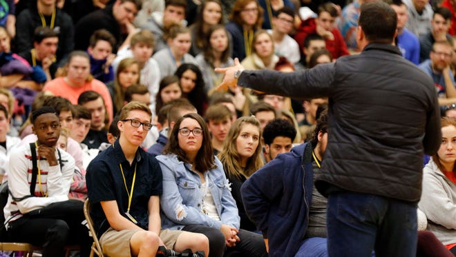 Former NBA basketball player Chris Herren speaks to Kickapoo students about his struggles with addiction in Springfield on December 15, 2017.