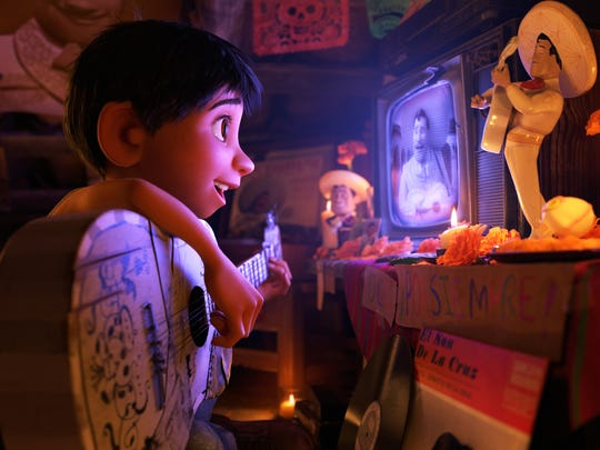 Miguel (voiced by Anthony Gonzalez) plays his music in secret in Pixar's animated 'Coco.'