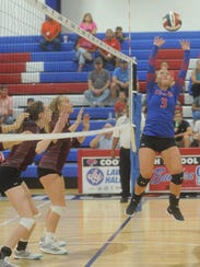 Cooper's Pearce Bjorlie, right, sets the ball against