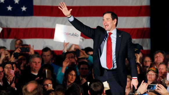 Marco Rubio waves to supporters at a campaign rally