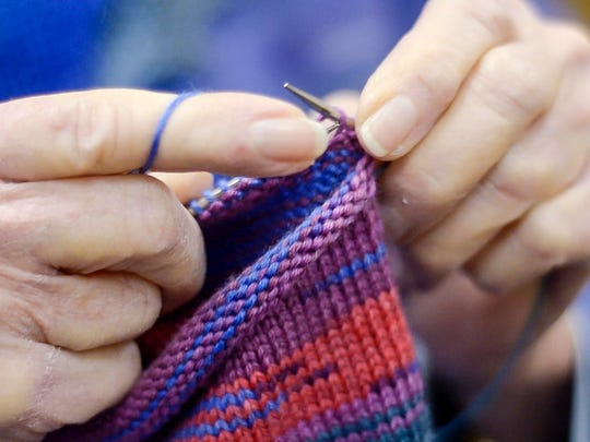 Marilyn Heilferty of Shelburne knits a pair of socks for a granddaughter during a weekly knitting klatch and Must Love Yarn in Shelburne on Wenesday, November 29, 2017.