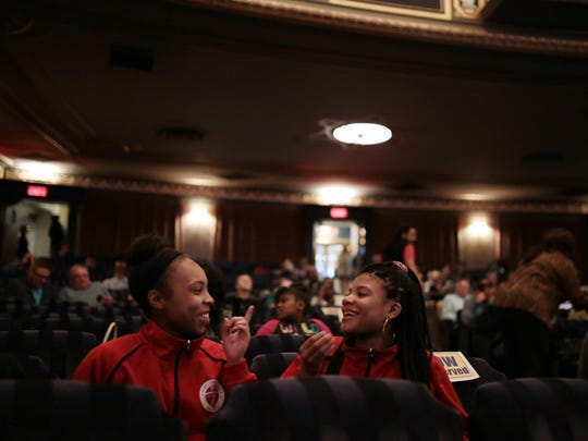 Cala Oatis, left, 16, and Mariah Ingram, 16, both from Downtown Boxing, chat ahead of the opening night of the third annual Freep Film Festival on Thursday at the Cinema Detroit of the Detroit Institute of Arts in downtown Detroit.
