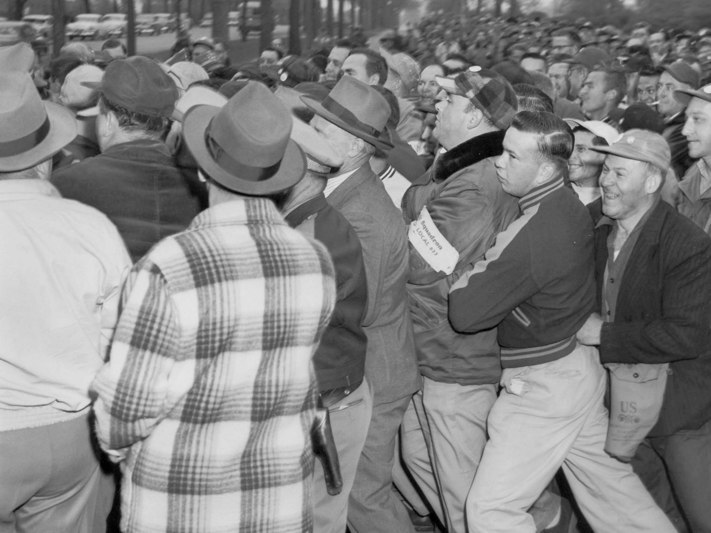 Union members on strike push against the crowd during an attempt by about 40 non-strikers to pass through the picket line in the early hours of May 24, 1954, at the employment office gate in Kohler.
