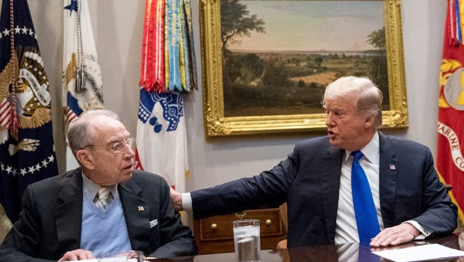 President Donald Trump, accompanied by Sen. Chuck Grassley, R-Iowa, left, speaks at a Jan. 4 meeting in the Roosevelt Room at the White House.
