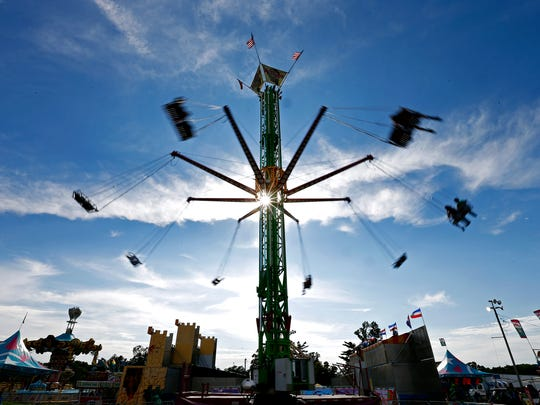 Attendees to the 79th annual Ozark Empire Fair ride