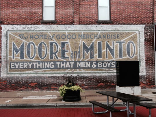 "In Milan, this restored image on the Milan Medical Clinic previously advertised ""The home of good merchandise: Moore and Minto."" The building formerly housed the store, and Mark Serra of Ferndale brought fresh vibrance to the piece on 3 East Main Street, facing the town square known as Tolan Square in Milan."