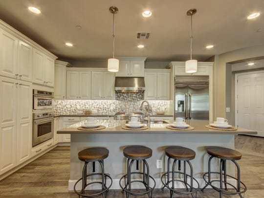 The gourmet-style kitchen areas include expanded islands.