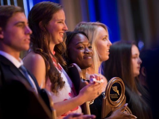 Student-athletes Winged Foot Scholar nominees, including Immokalee High School graduate Azariah Howard, center, are announced during the Winged Foot Scholarship Awards Banquet at the Naples Grand Beach Resort Thursday, May 25, 2017 in Naples.