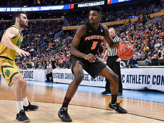 Princeton Tigers guard Amir Bell (5) looks to drive against Notre Dame Fighting Irish guard Matt Farrell (left) in the 2017 NCAA Tournament. Both local guys are entering the professional ranks this summer.