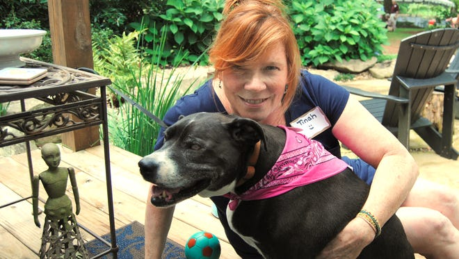 Tinah Utsman with Carma, her adopted, blind, senior rescue dog