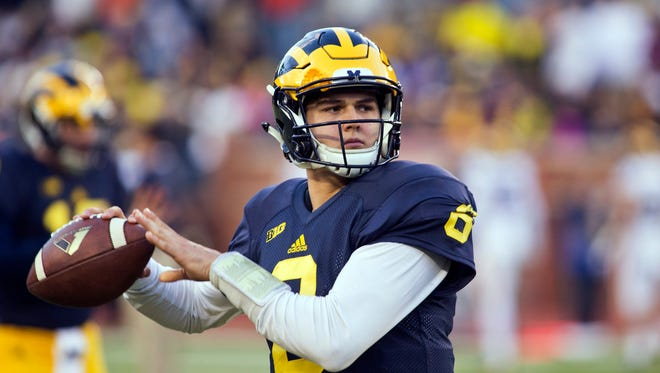 Michigan quarterback John O'Korn warms up during the NCAA college football team's annual spring game at Michigan Stadium in Ann Arbor, Mich., Friday, April 1, 2016.