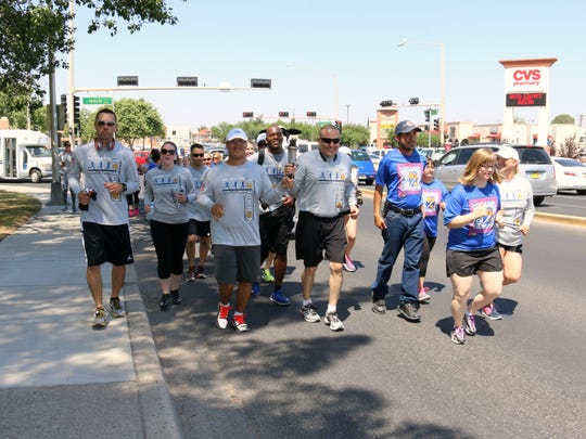 Runners participate in the 2016 Law Enforcement Torch Run near Albert Johnson Park