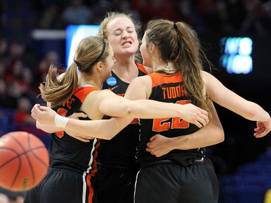 Oregon State's Mikayla Pivec, Marie Gulich and Kat Tudor, from left, celebrate after Oregon upset Baylor in an NCAA women's college basketball tournament regional semifinal Friday, March 23, 2018, in Lexington, Ky. (AP Photo/James Crisp)