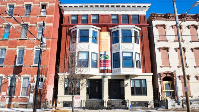 3CDC developed the Parksite project, which involved the renovation of two historic buildings into eight condominiums on Race Street directly across from Washington Park.