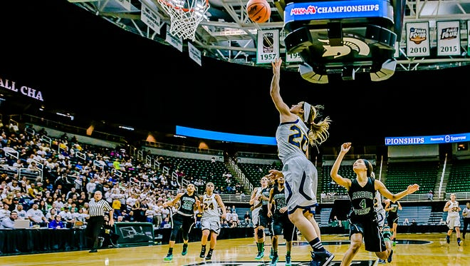 Brooklyn Dolloff ,20, of Ithaca lays the ball in over Nastassja Chambers ,4, of Ypsilanti Arbor Prep during 1st quarter action in their Class C state semifinal game Thursday March 17, 2016 at the Breslin Center in East Lansing.